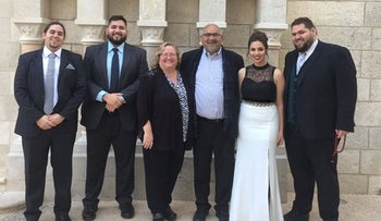 The Zoughbis with their children Tariq, Marcelle, Lucas and Rafiq in Bethlehem, West Bank.