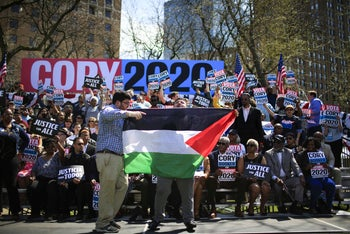 A protester is removed from the guest area as he shouts pro-Palestine slogans while Sen. Cory Booker (D-NJ) speaks to supporters during a campaign event in Newark, New Jersey, April 13, 2019.