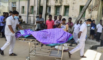 Sri Lankan hospital workers transport a body on a trolley at a hospital morgue following an explosion at a church in Batticaloa in eastern Sri Lanka on April 21, 2019.