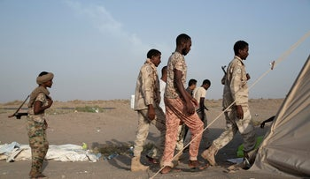 Sudanese militiamen fighting under the command of the United Arab Emirates along the coastal highway leading to the contested port of Hudaydah, Yemen, October 2, 2018.