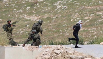 Palestinian teen Osama Hajajeh attempting to flee Israeli soldiers, Tuqu, West Bank, April 18, 2019.
