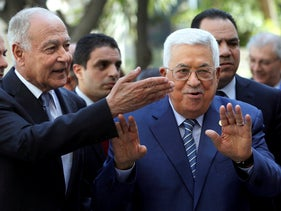 Arab League Secretary-General, Ahmed Aboul Gheit, left, welcomes Palestinian President Mahmoud Abbas to the Arab League headquarters in Cairo, Egypt Sunday, April 21, 2019.