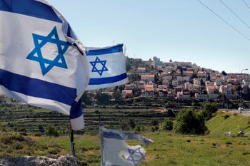 Israeli flags in front of the Israeli settlement of Efrat situated on the southern outskirts of the West Bank city of Bethlehem. April 12, 2019