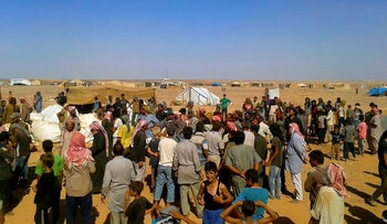 File photo: Displaced people wait to receive aid at the Rukban camp, near the Jordan-Syria border, August 4, 2016.