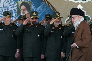 File photo: Gen. Hossein Salami, second right, salutes as Supreme Leader Ayatollah Ali Khamenei arrives at a graduation ceremony of the Revolutionary Guard's officers in Tehran, Iran, May 20, 2015.