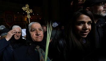File photo: Syriac Orthodox pilgrims carry palm branches during during the Palm Sunday procession at the Church of the Holy Sepulchre in Jerusalem's Old City, April 21, 2019.