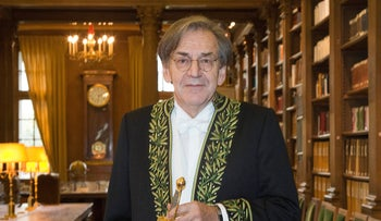 File photo: French philosopher Alain Finkielkraut displays his ceremonial epee in the library of the Institut de France on Jan. 28, 2016.