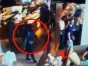 A man with a backpack walks in Shangri La hotel restaurant in Colombo, Sri Lanka, April 21, 2019 in this screen grab taken from a CCTV footage released on April 24, 2019.