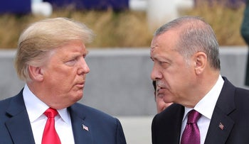 U.S. President Donald Trump, left, talks to Turkish President Recep Tayyip Erdogan, right, as they tour the new NATO headquarters in Brussels, Belgium, Wednesday, July 11, 2018.