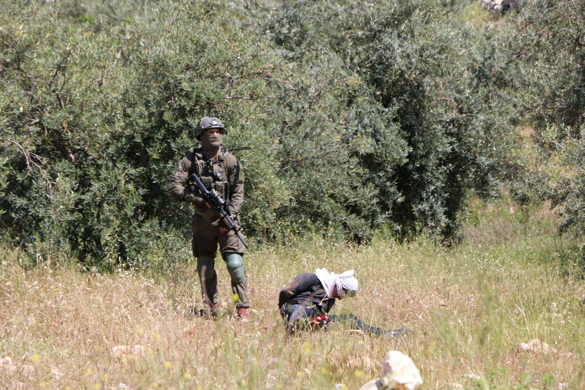Palestinian teen Osama Hajajeh bounded and blindfolded by Israeli soldiers, Tuqu, April 18, 2019.