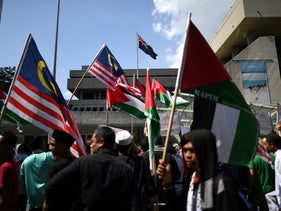 Demonstrators outside the Australian embassy in Kuala Lumpur protest against Australia's decision to recognize Jerusalem as Israel's capital, December 21, 2018.