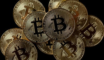 FILE PHOTO: A collection of Bitcoin (virtual currency) tokens are displayed in this picture illustration taken December 8, 2017.