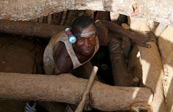 An artisanal gold miner emerges from a pit at an unlicensed mine near the city of Bouna, Ivory Coast, February 11, 2018.