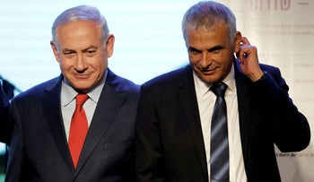 File photo: Israeli Prime Minister Benjamin Netanyahu and Finance Minister Moshe Kahlon attend a ceremony for the signing of a housing agreement in Sderot, Israel, April 9, 2018.