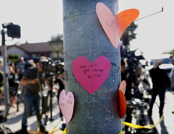 Hand-written notes are displayed on a light post across the street from the Chabad of Poway Synagogue after a shooting in Poway, California, April 27, 2019.