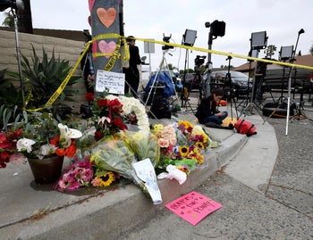 Flowers and signs sit at a memorial across the street from the Chabad of Poway synagogue in Poway, Calif., on Sunday, April 28, 2019.