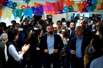 Spanish far-right party VOX leader and candidate for prime minister Santiago Abascal (C) arrives to vote at a polling station in Madrid during general elections in Spain on April 28, 2019.