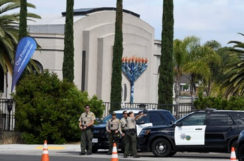 San Diego county sheriff deputies stand in front of the Chabad of Poway synagogue, April 28, 2019.