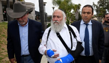 Rabbi Yisroel Goldstein, center, arrives for a news conference at the Chabad synagogue in Poway, Calif., on Sunday, April 28, 2019.