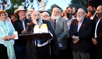 Chabad of Poway Rabbi Yisroel Goldstein addressing attendees at the vigil on April 28, a day after a shooter opened fire in his shul, killing one congregant and injuring three, including him.