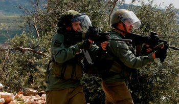 File photo: Israeli soldiers take aim at Palestinian protesters following a weekly demonstration near Nablus in the West Bank, April 19, 2019.