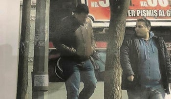 In this grab taken from video on Friday, April 19, 2019. provided by Turkey's state-run news agency, two alleged intelligence officers from the United Arab Emirates, walk in Istanbul. Turkish authorities have detained two people on suspicion of spying for the United Arab Emirates, Turkey's state-run news agency reported on Friday.