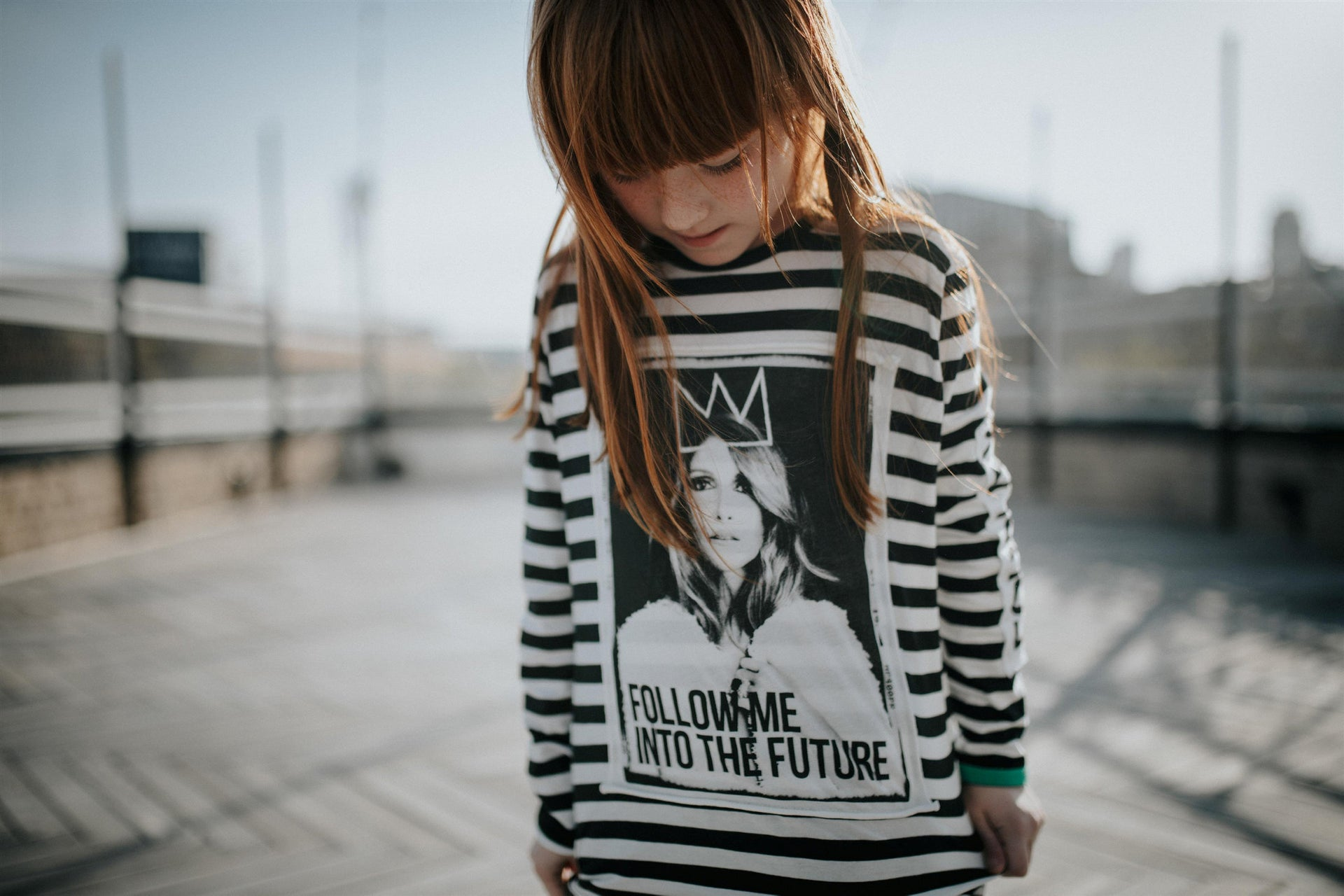 A girl wearing a shirt by Celinununu. A better future.