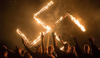 File photo: Supporters of a white nationalist political group take part in a swastika burning at an undisclosed location in Georgia, U.S., April 21, 2018.