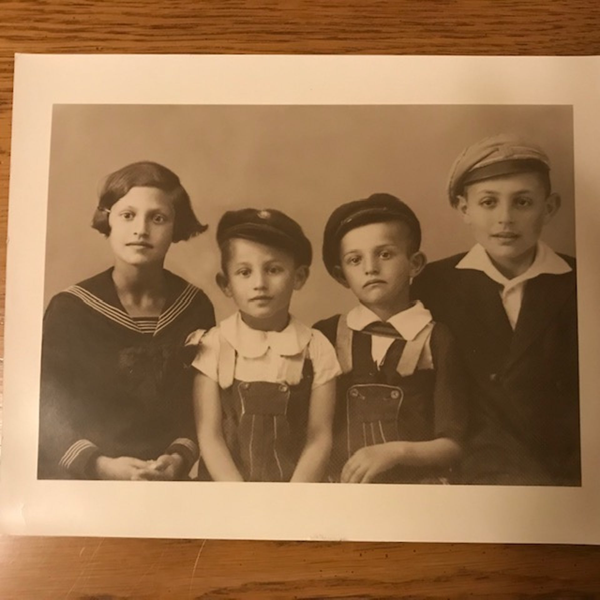 An undated picture of Judit Ornstein with three of her brothers (from left): Tibor (Tibi), Zoltán (Zoli) and Paul.
