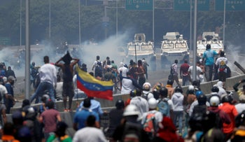 Opposition demonstrators face military vehicles near the Generalisimo Francisco de Miranda Airbase 'La Carlota' in Caracas, Venezuela April 30, 2019.