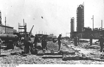 Forced laborers outside the Auschwitz factory, in 1941.