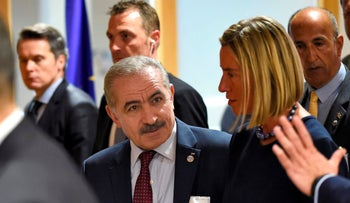The EU's Federica Mogherini arrives with Palestinian Prime Minister Mohammad Shtayyeh before their annual spring meeting of the International donor group for Palestine at the EU headquarters in Brussels on April 30, 2019.