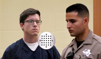 John Earnest, accused in the fatal shooting at the Chabad of Poway synagogue, stands in court near a San Diego County Bailiff during an arraignment hearing in San Diego, April 30, 2019.