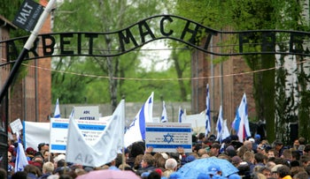 FILE Photo: People walk through the main gate of Auschwitz during the 'March of the Living' in Oswiecim, Poland.