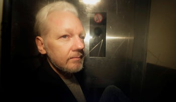 WikiLeaks founder Julian Assange being taken from court, where he appeared on charges of jumping British bail seven years ago, in London, May 1, 2019.