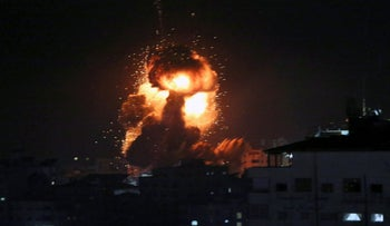 File Photo: An explosion caused by Israeli airstrikes is seen in Gaza City, March 25, 2019.