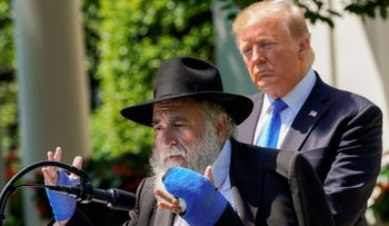 Rabbi Yisroel Goldstein, injured in the recent synagogue shooting in Poway, speaks as U.S. President Donald Trump looks on, Washington D.C., May 2, 2019.