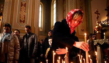 File Photo: Ukrainians pray at the St. Mary Magdalene Church in Warsaw, Poland, March 10, 2019.
