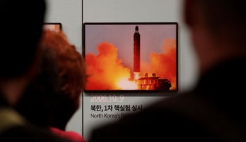 File photo: Visitors watch a photo showing North Korea's missile launch at the Unification Observation Post in Paju, South Korea, near the border with North Korea, April 19, 2019.