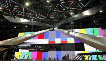 Workers build the stage of the Eurovision Song Contest at Expo Tel Aviv, April 15, 2019.