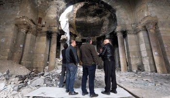 People check the damaged dome inside the al-Halwani mosque in the old city of Aleppo, Syria, April 11, 2019.
