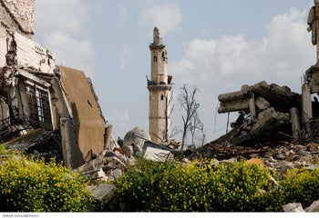 Blossoming vegetation is seen near the damaged minaret of the Tawashi mosque in the old city of Aleppo, Syria, April 9, 2019.