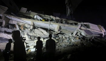 Residents inspect the remains of a destroyed building in Gaza City, May 4, 2019.