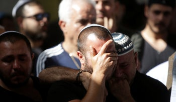 People cry during the funeral of Moshe Agadi in the city of Ashkelon, Israel, May 5, 2019.