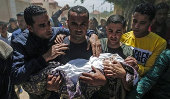 Palestinian mourners carry the shrouded body of Saba Abu Arar during her funeral in Gaza City on May 5, 2019.