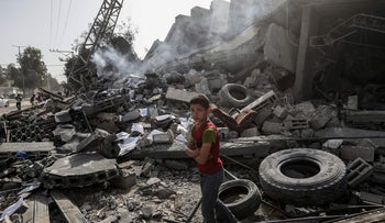 A Palestinians boy stands in rubble of a destroyed building, Gaza City, May 6, 2019.