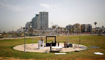 Laborers work on the construction of the Eurovision Village, a space dedicated for fans of the upcoming Eurovision Song Contest, in Tel Aviv, Israel, May 6, 2019.