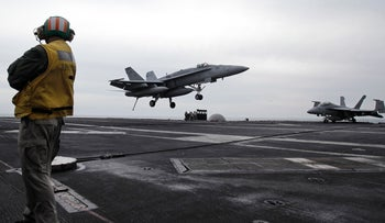 FILE Photo: A U.S. fighter jet lands on the USS Abraham Lincoln aircraft carrier during exercises in the Persian Gulf.