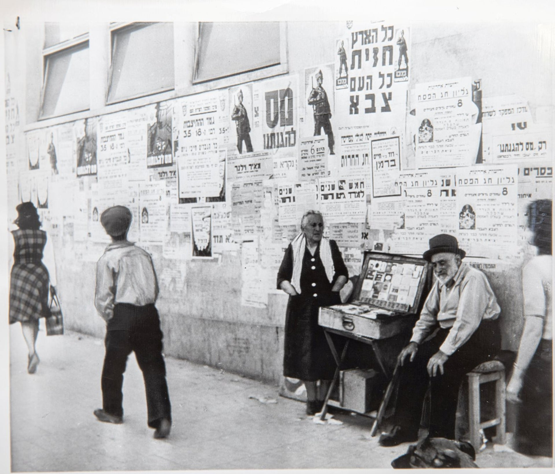 Tel Aviv street walls in covered with mobilization posters May 15 1948.