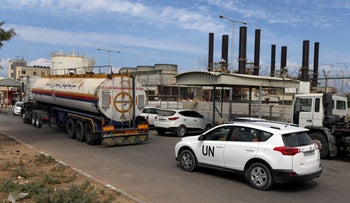 FILE PHOTO: A United Nations vehicle follows a fuel tanker as it arrives at the Gaza power plant, Gaza Strip, October 9, 2018.